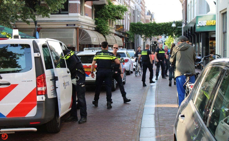 Verdachte Vlucht en springt de Stadsgracht in